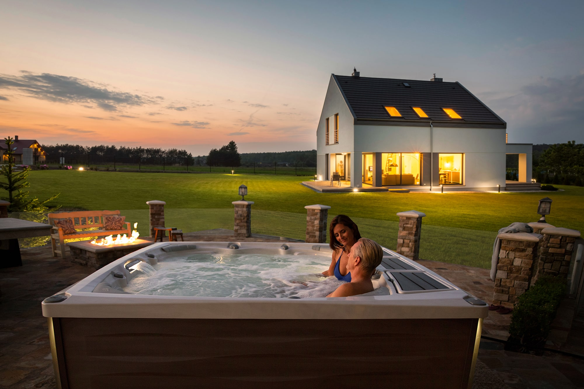 Sundance Spas hot tub couple sunset in Redding, CA